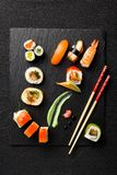 Sushi on black stone plate on a stone table Royalty Free Stock Photo
