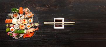 Sushi on a black wooden surface.  Royalty Free Stock Photo