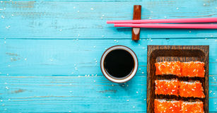 Sushi on board, pink chopsticks Royalty Free Stock Photography