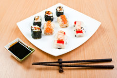 Sushi with bowl of sauce and chopsticks Stock Image