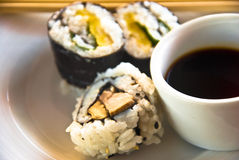 Sushi and bowl of soy sauce royalty free stock image