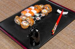 sushi box with assorted with sushi pieces stock photos