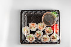 Sushi box. Japan menu in black transport box or bento box on gray background, top view, close up, from above Stock Image