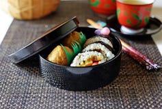 Sushi box lunch. A closeup of a Japanese sushi obento--box lunch--of makizushi and inarizushi Stock Image