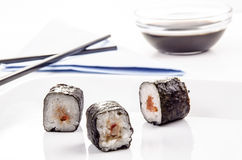 Sushi and brown chopsticks Royalty Free Stock Photo
