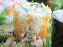 Sushi California Roll. A platter of various kinds of sushi...shrimp tempura, california rolls, salmon rolls, cucumber rolls, and the house special Royalty Free Stock Photography