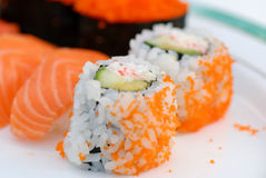 Sushi and California Roll. On white Royalty Free Stock Photos