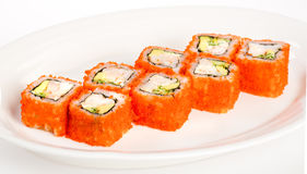 Sushi (California Roll). Japanese Cuisine - Sushi (California Roll) on a white background Royalty Free Stock Images