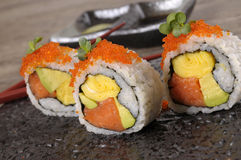 Sushi california roll on black plate. California roll sushi with caviar on black plate Royalty Free Stock Photography