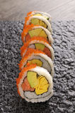 Sushi California roll on black plate. California roll sushi with caviar on black plate Royalty Free Stock Image
