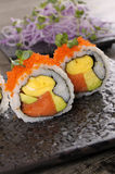 Sushi california roll on black plate. California roll sushi with caviar on black plate Stock Photos