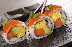 Sushi california roll. California roll sushi with caviar on a black plate Royalty Free Stock Photo