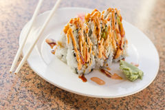 Sushi California Roll. Fancy California sushi roll topped with sushi sauce and spicy mayonnaise Royalty Free Stock Photos