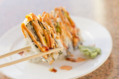 Sushi California Roll. Fancy California sushi roll topped with sushi sauce and spicy mayonnaise Royalty Free Stock Photo