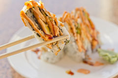 Sushi California Roll. Fancy California sushi roll topped with sushi sauce and spicy mayonnaise Royalty Free Stock Photography