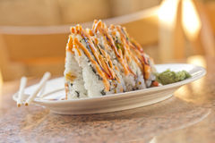 Sushi California Roll. Fancy California sushi roll topped with sushi sauce and spicy mayonnaise Stock Photo