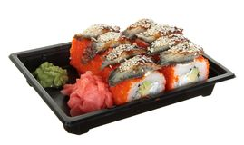 Sushi California. Sushi California - a Roll made of Crab meat, Avocado and a cucumber inside. Caviar of red flying fish of Tobiko outside Royalty Free Stock Image