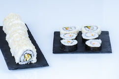 Sushi, california roll with sesame seeds. Maki sushi, rolls on slate plate Stock Photo
