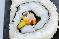 Sushi, california roll with sesame seeds. Sushi, california roll with sesame seeds on a slate plate Stock Photo