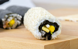 Sushi, california roll with sesame seeds. Sushi, california roll with sesame seeds on a slate plate Royalty Free Stock Image