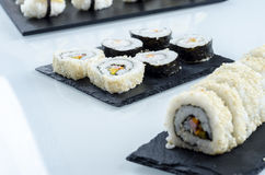 Sushi, california roll with sesame seeds. Sushi, california roll with sesame seeds on a slate plate Stock Photography