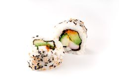 Sushi: California Rolls. Two california sushi rolls isolated against a white background Stock Photos