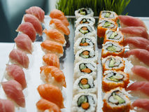Sushi and California Rolls on Glass Tray Stock Photo