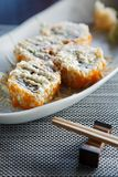 Sushi california rolls with topping mayonnaise  on matt and chopstick beside Stock Images