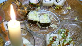 The Sushi by candlelight. The video shows set of different sushi by candlelight stock footage