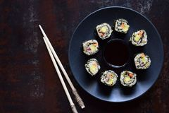 Sushi from cauliflower, avocado, tuna and carrots. Traditional Asian food. Diet healthy food concept. Cereals free. Gluten free. D. Airy free. AIP Autoimmune stock images