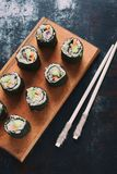 Sushi from cauliflower, avocado, tuna and carrots. Traditional Asian food. Diet healthy food concept. Cereals free. Gluten free. D. Airy free. AIP Autoimmune royalty free stock photos