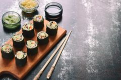 Sushi from cauliflower, avocado and tuna. Traditional Asian food. Diet healthy food concept. Cereal free. Gluten free. Dairy free. AIP Autoimmune Paleo stock photo