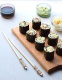 Sushi from cauliflower, avocado and tuna. Traditional Asian food. Diet healthy food concept. Cereal free. Gluten free. Dairy free. AIP Autoimmune Paleo stock photos