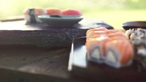 Sushi Changing focus. Changing focus distance at japanese sushi rolls stock video footage