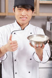Sushi chef cooks rice Stock Images