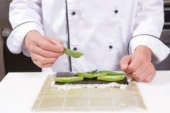 Sushi chef cooks sushi Stock Photography