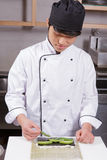 Sushi chef cooks sushi Royalty Free Stock Photography