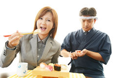 Sushi chef and customer Royalty Free Stock Photography