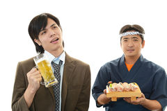 Sushi chef and customer Stock Images