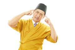 Sushi chef having a headache Stock Photos