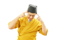 Sushi chef having a headache Royalty Free Stock Photos