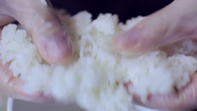 Sushi chef preparing rice for sushi roll. Sushi chef preparing rice for a sushi roll stock video