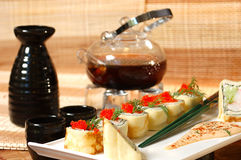 Sushi with chinese tea. On a table at restaurant royalty free stock photo