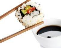 Sushi on chopstick Stock Image