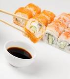Sushi on chopstick Stock Images