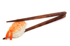 Sushi with chopstick. Japanese food against white background stock photos