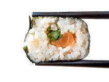 Sushi on a chopstick. Sushi on a black chopstick royalty free stock photo