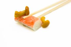 Sushi on chopstick with mushrooms Royalty Free Stock Images