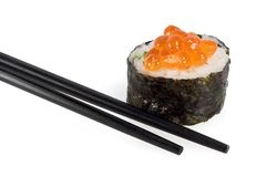 Sushi with chopsticks. On a white background Royalty Free Stock Image