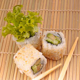 sushi with chopsticks Royalty Free Stock Photos